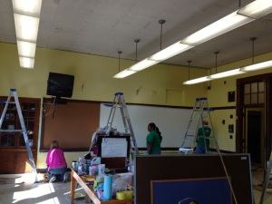 Fidelity volunteers finish up the new white board.